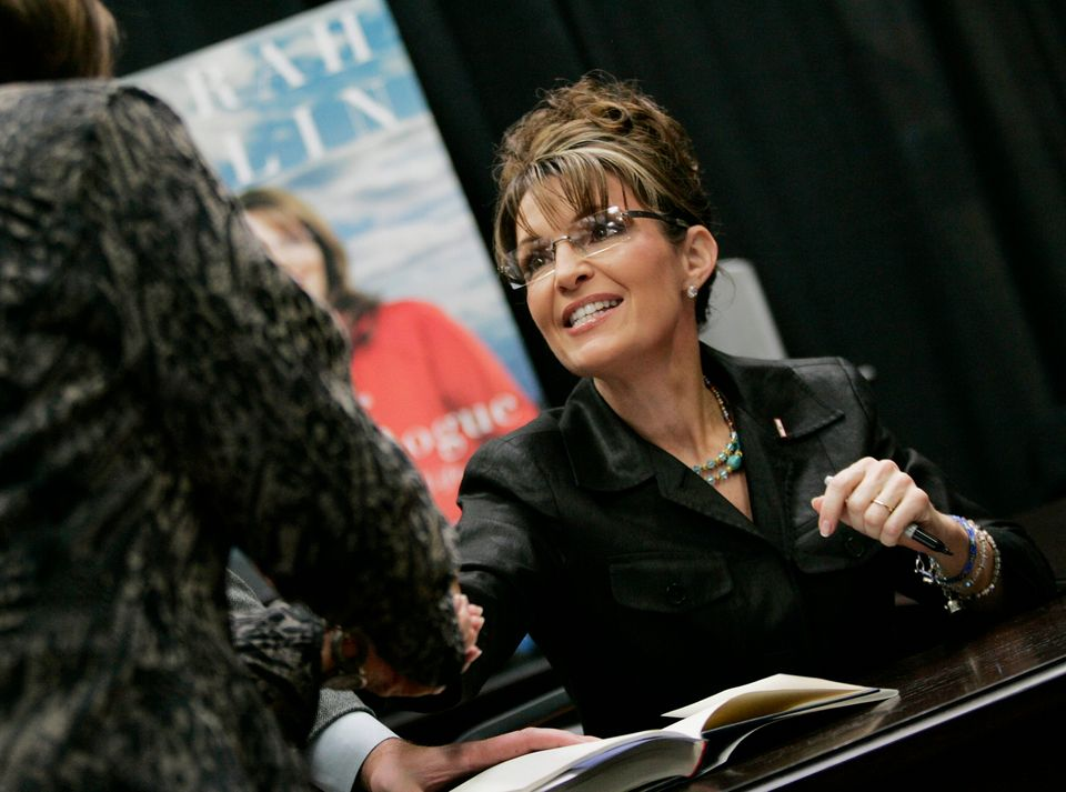 Sarah Palin, former vice presidential candidate and governor of Alaska, signs a book at Sam's Club in...