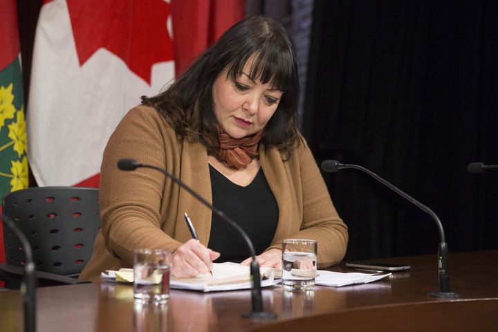 Natalie Mehra, executive director of the Ontario Health Coalition, makes a note before speaking to reporters at Queen's Park in Toronto on Jan. 21, 2019.