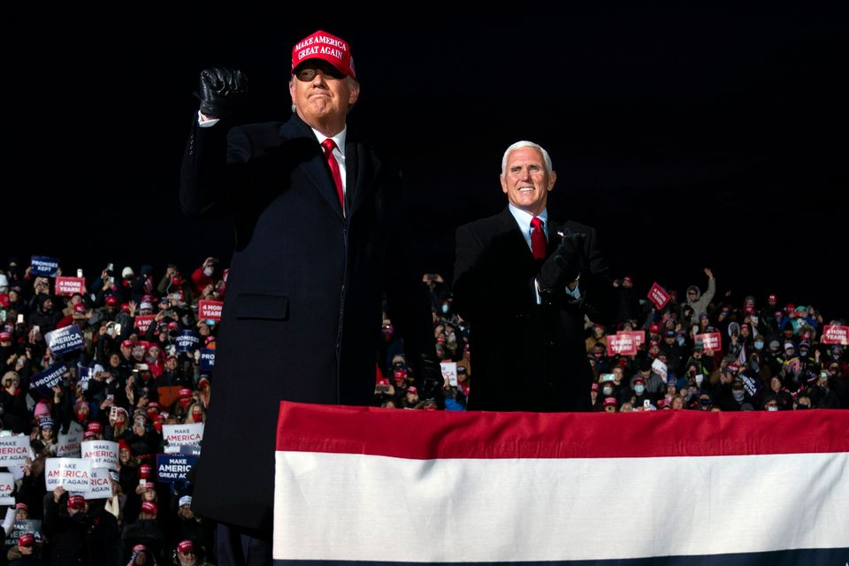President Donald Trump and Vice President Mike Pence arrive for a campaign rally at Cherry Capital Airport,...