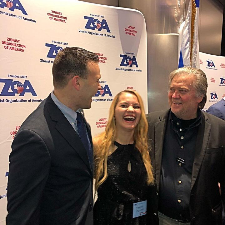 Jack Posobiec, his wife, Tanya Gorbach, and Steve Bannon share a laugh in 2017.