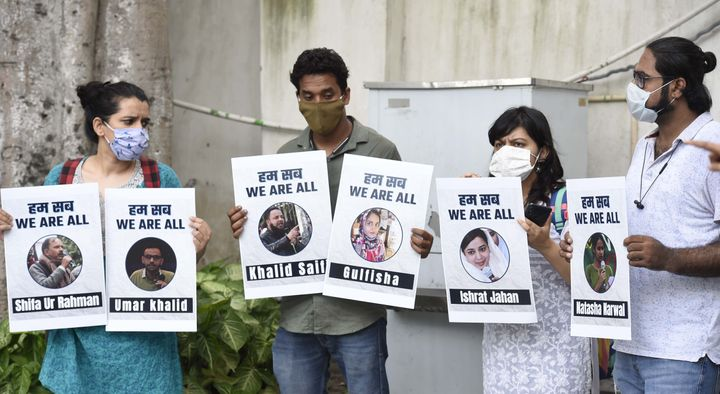 People hold placards during a press conference on the arrest of student activist Umar Khalid, on September 16, 2020 in New Delhi, India.
