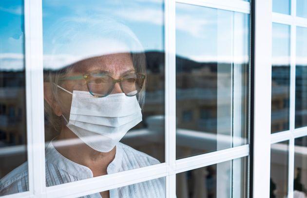 Coronavirus pandemic, senior woman in self quarantine to avoid contagion of infection by virus covid-19....