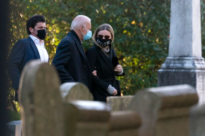 Democratic presidential candidate former Vice President Joe Biden walks with his granddaughter Finnegan Biden into St Joseph