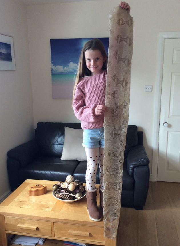 Amelia Drewett, seven, poses alongside her trophy