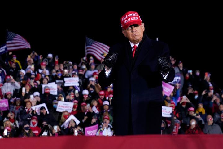 President Donald Trump dances after a campaign rally at Gerald R. Ford International Airport in Grand Rapids, Michigan, early
