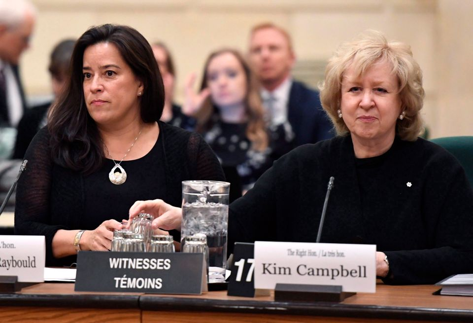 MP Jody Wilson-Raybould, left, and former prime minister Kim Campbell sit beside each other at a House...
