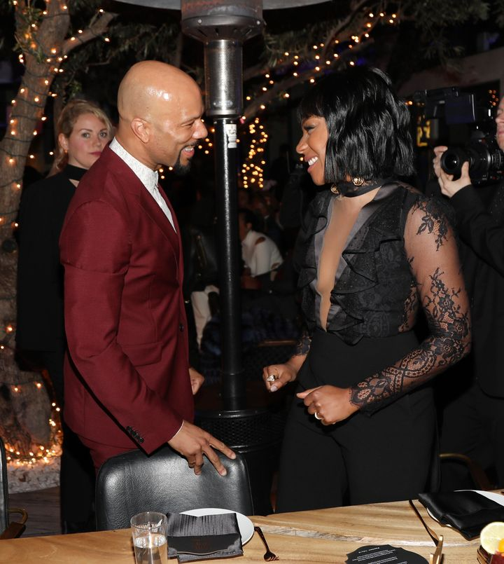 """Common and Tiffany Haddish at the rapper's """"Toast to the Arts"""" event in 2018 in West Hollywood, California."""