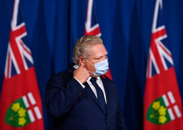 Ontario Premier Doug Ford arrives at a press conference at Queen's Park during the COVID-19 pandemic...