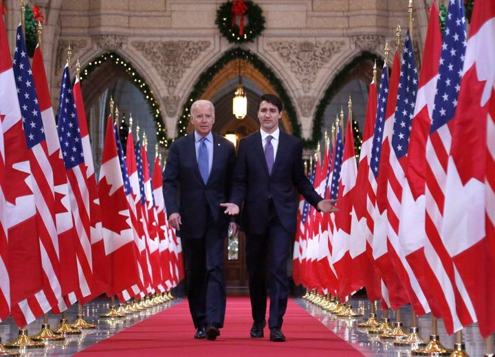 Prime Minister Justin Trudeau and then-U.S. vice-president Joe Biden walk down the Hall of Honour on Parliament Hill on Dec. 9, 2016.