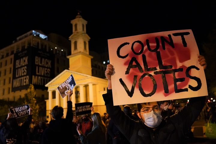A demonstrator holds up a sign while waiting for election results at Black Lives Matter Plaza, on Nov. 3, 2020, in Washington