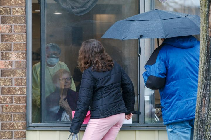 A family has a window visit with their mother at Orchard Villa in Pickering, Ont. on Mother's Day, May 10, 2020
