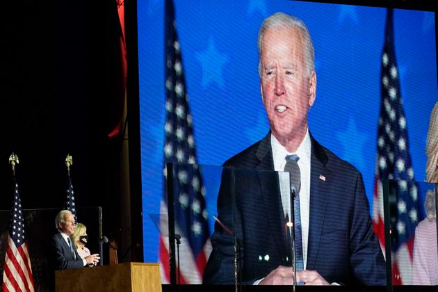 Democratic presidential candidate former Vice President Joe Biden speaks to supporters, early Wednesday,...