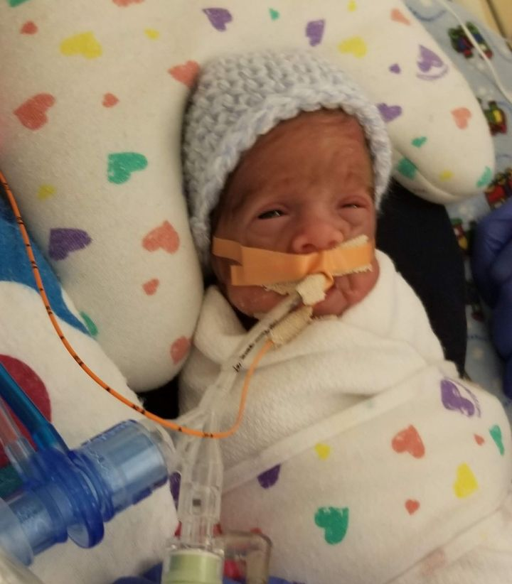 Ronan wasn't able to wear any clothes while he was alive, but his primary NICU nurse did manage to find a hat small enough to