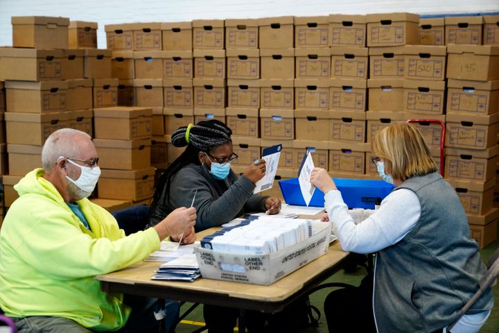 Election workers in Chester County, Pennsylvania, processing mail-in and absentee ballots on Wednesday. President Donald Trum