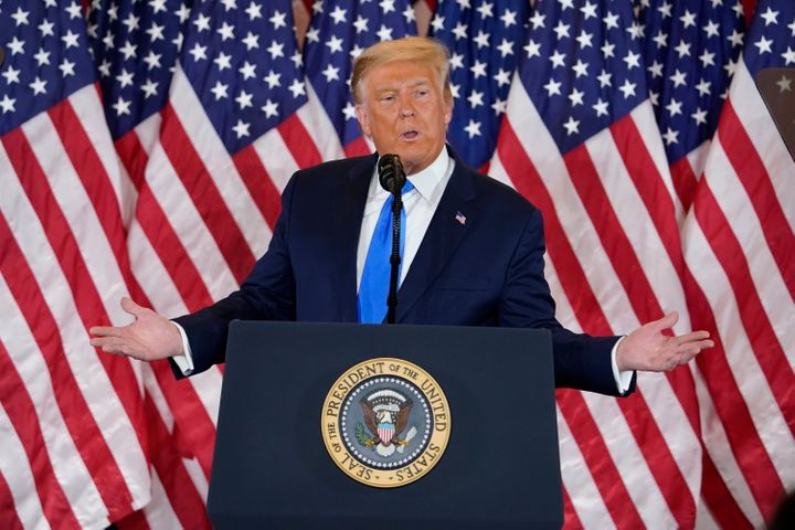 """Donald Trump first declared victory in the early hours of Wednesday morning, well before a number of states were called. He preemptively declared a """"BIG"""" win and tweeted, falsely, that Democrats """"are trying to STEAL the election"""" - Trump pictured here on November 4 in Washington"""