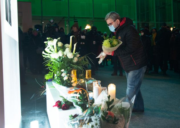 Quebec City Mayor Regis Labeaume lays flowers at a vigil to honour Francois Duchesne who was stabbed...