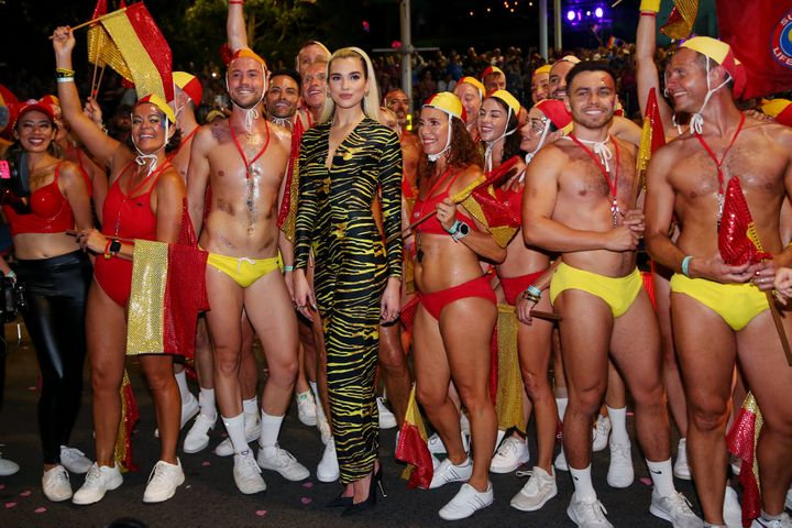Dua Lipa poses amongst life guards during the 2020 Sydney Gay & Lesbian Mardi Gras Parade on February 29, 2020 in Sydney, Australia.