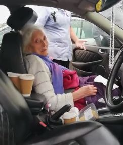 Woman being taken out of care