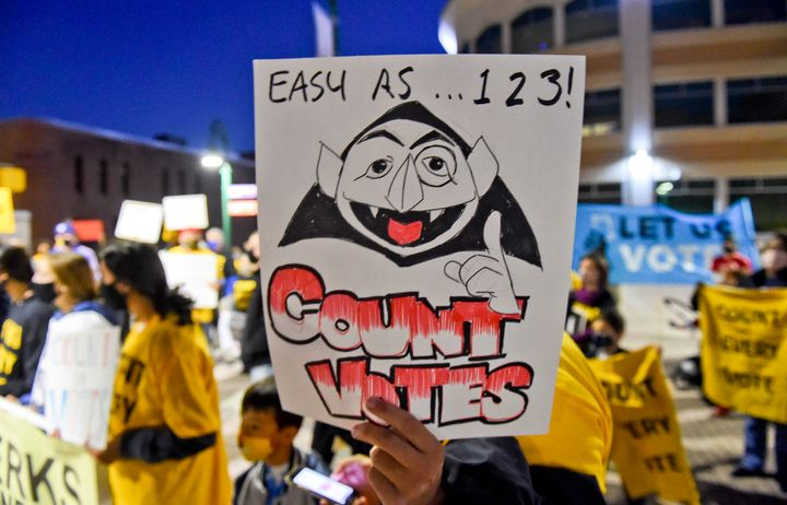 A rally participant holds a sign with a drawing of The Count in Reading, Pennsylvania, on Wednesday.