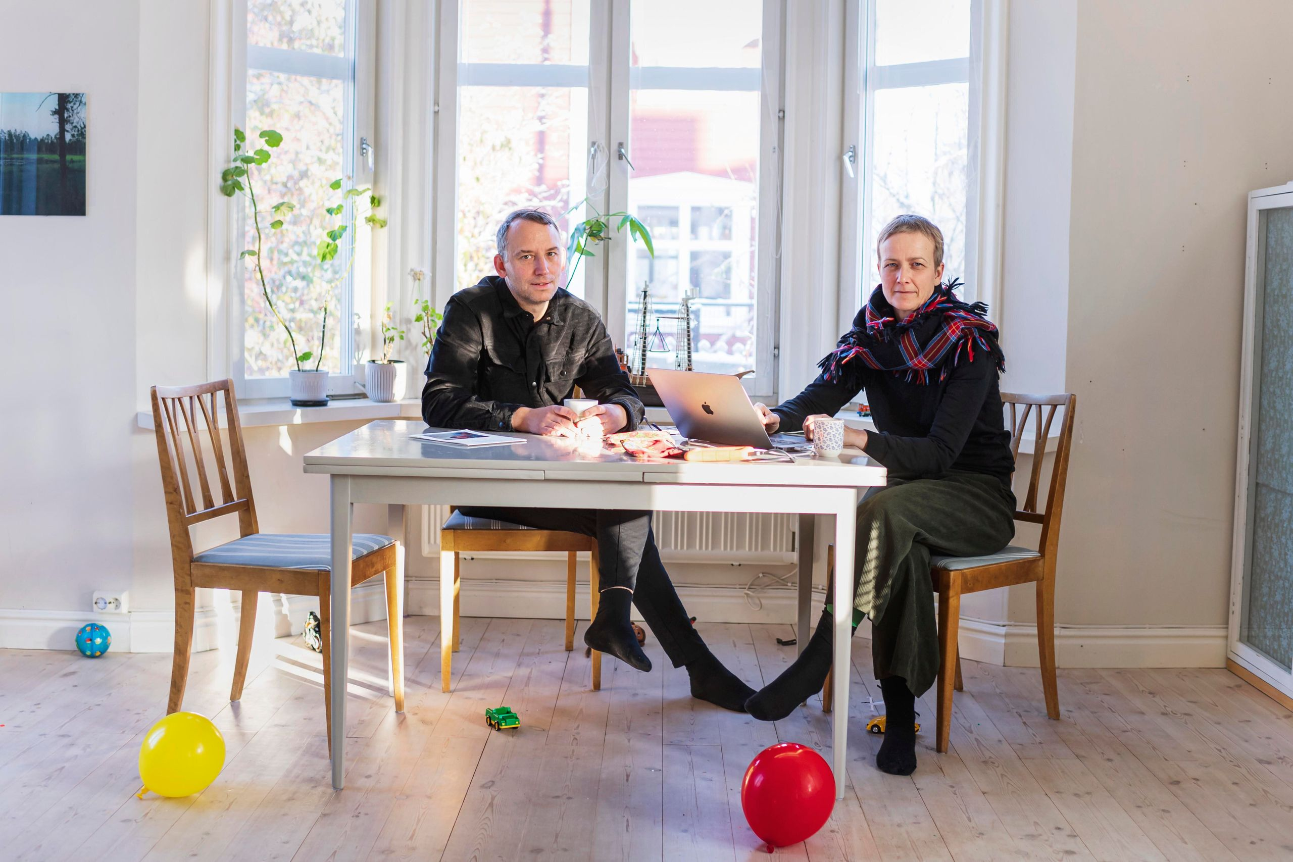 Anja and Tomas Örn, two artists, relax in their living room. They live inSvartöstaden and, like many resident
