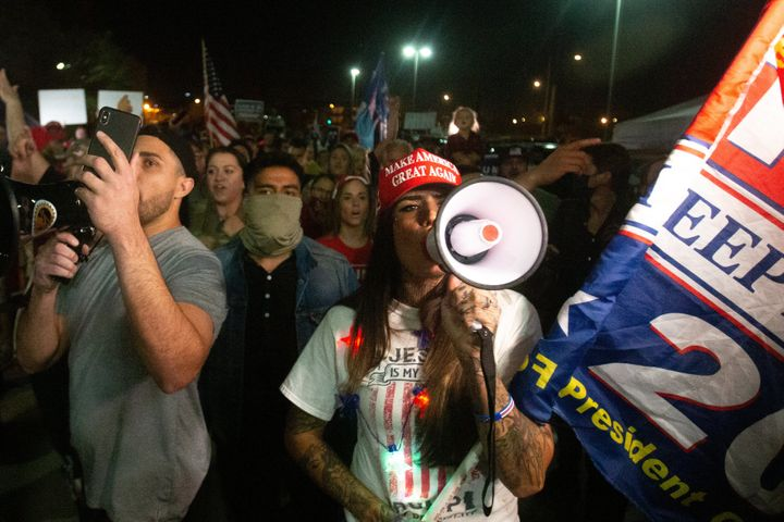 Supporters of President Donald Trump protest at the Maricopa County Elections Department office on Nov. 4 in Phoenix. The dem