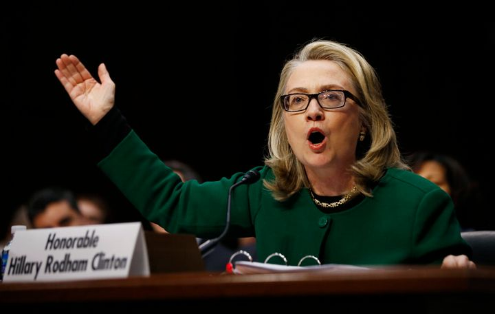 Then-Secretary of State Hillary Clinton pounds on a table responding to Senate Foreign Relations Committee Chair Ron Johnson