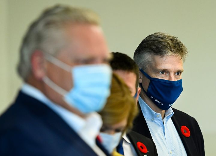 Ontario Finance Minister Rod Phillips, right, and Premier Doug Ford deliver baked goods and coffee to workers at Humber River Hospital Nov. 5, 2020.