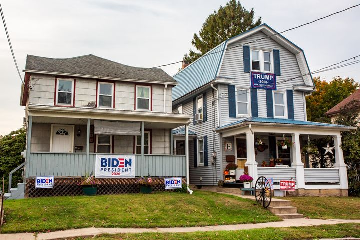 Neighboring houses in Northumberland, Pennsylvania, display signs for opposing presidential candidates. Friendships across party lines are becoming uncommon -- and even family members are at odds.