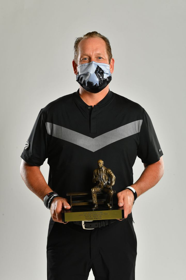 Nick Nurse's Coach of the Year photo wearing Nadia's BLM mask.