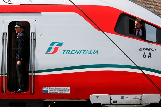 Trenitalia's conductors look before to leave by Frecciargento's train at the Vatican railway station...