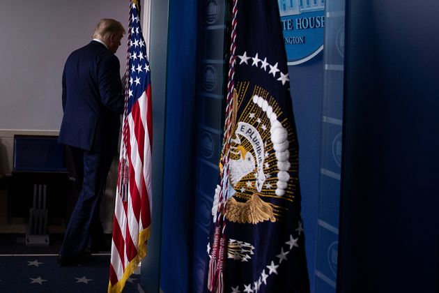 TOPSHOT - US President Donald Trump leaves after addressing the press from the Brady Briefing Room at...