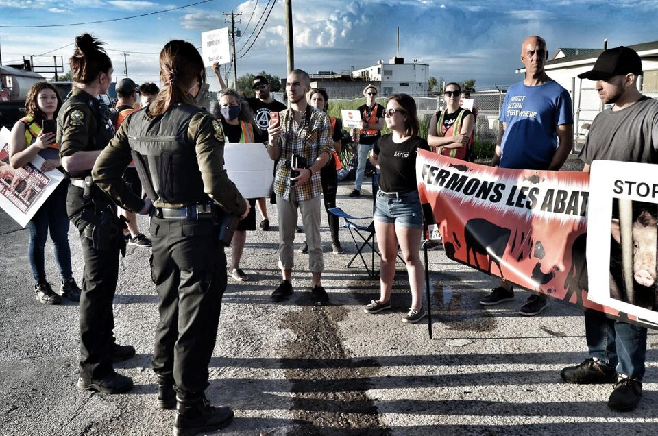 Pascal Bédard (second from right) during a demonstration in front of the Olymel pig slaughterhouse...
