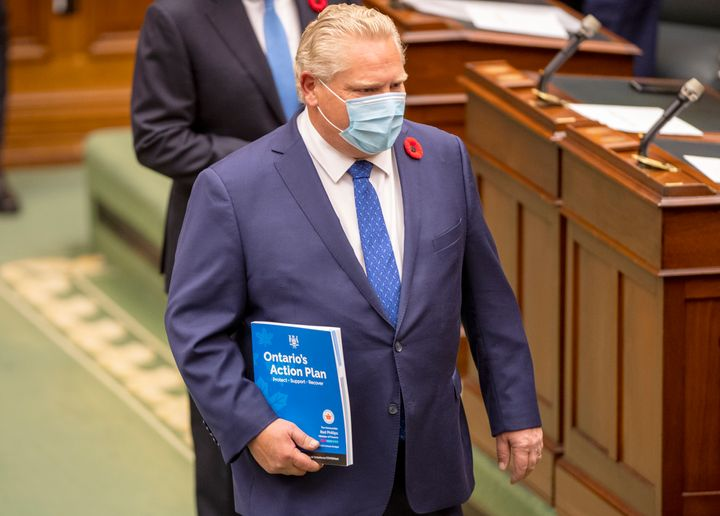 Ontario Premier Doug Ford carries the Ontario 2020 Budget as he arrives in the legislature in Toronto on Nov. 5, 2020.