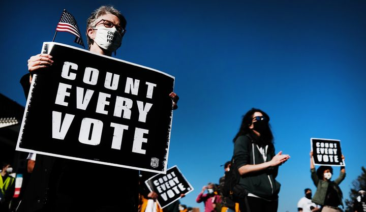 People participate in a protest in support of counting all votes on Nov. 4 in Philadelphia as the election in Pennsylvania is