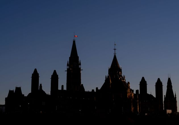 The Canada flag flies at half mast on the Peace Tower on Parliament Hill in Ottawa on Nov. 4, 2020. in...