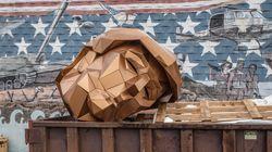 Artist Takes Giant Anti-Trump Sculpture On Dumpster, Junkyard 'Tour Of