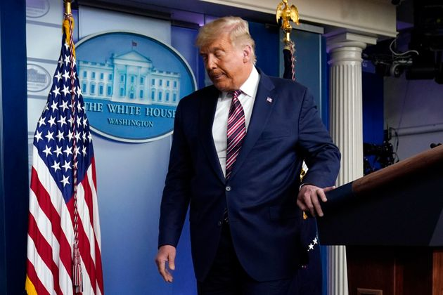 President Donald Trump leaves the podium after speaking at the White House, on