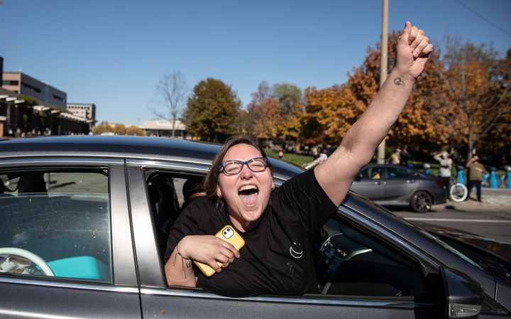 People celebrate from their cars outside Independence Mall in Philadelphia on Nov. 7.