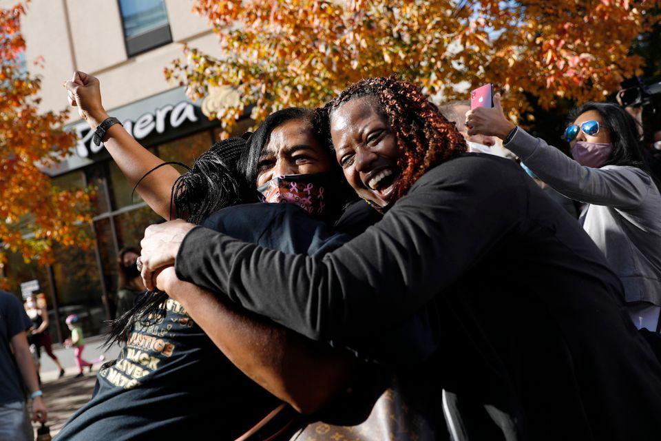 People celebrate Saturday, Nov. 7, 2020, in Philadelphia, after Democrat Joe Biden defeated President...