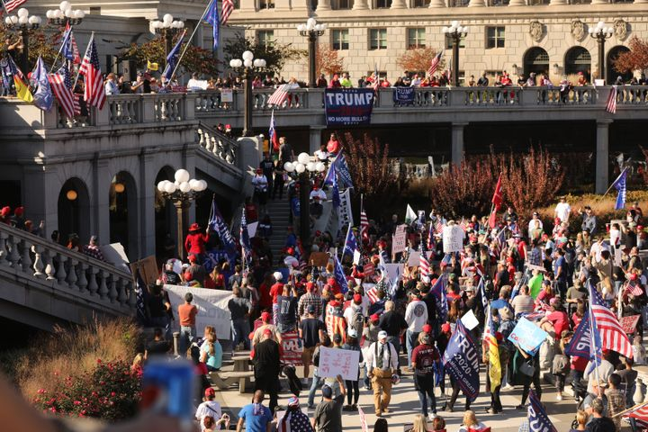 Trump supporters, QAnon believers and members of far-right militia groups gathered outside the Pennsylvania state Capitol, fa
