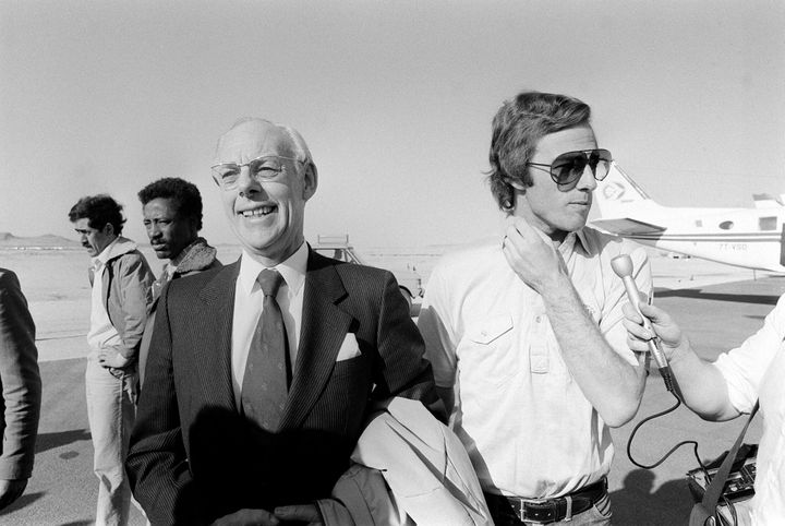 Denis Thatcher, left, with his son Mark Thatcher in January 1982. They're leaving the Algerian president's private jet after Mark was rescued during the Paris-Dakar rally.