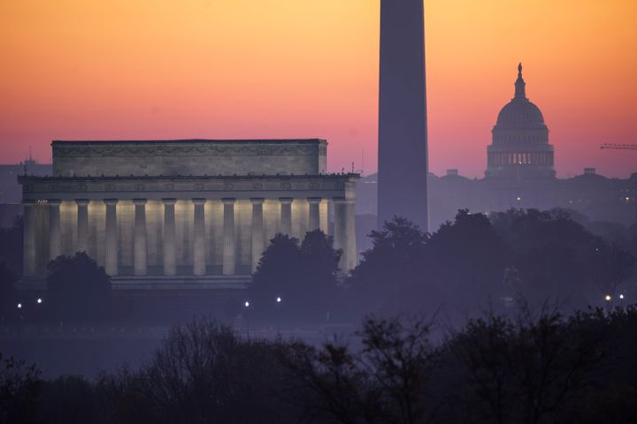 The Washington skyline is seen at dawn, Sunday, Nov. 8, 2020, the morning after incumbent President Donald Trump was defeated