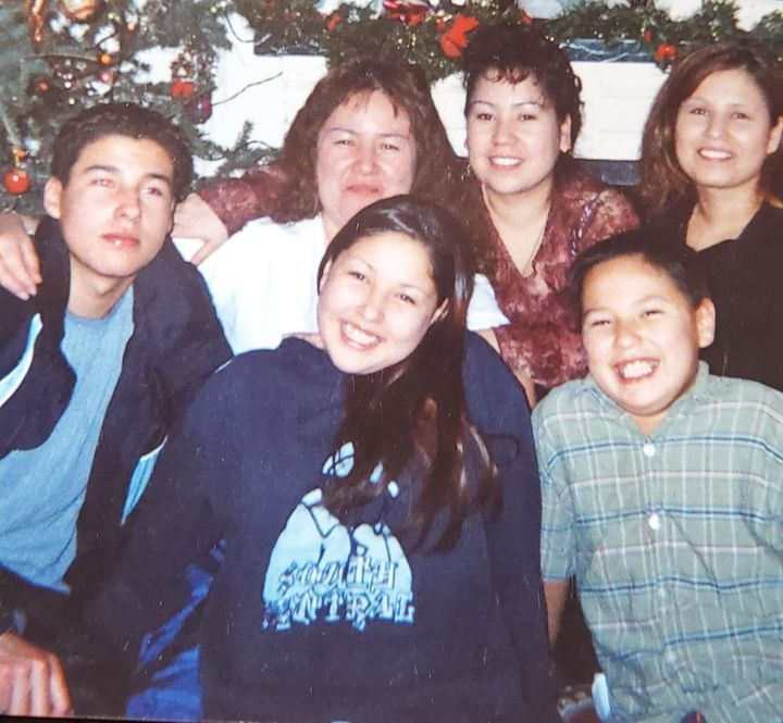 Bernice Catcheway, (second top left) and Jennifer Catcheway (below Bernice) and her siblings in happier times before she went missing.