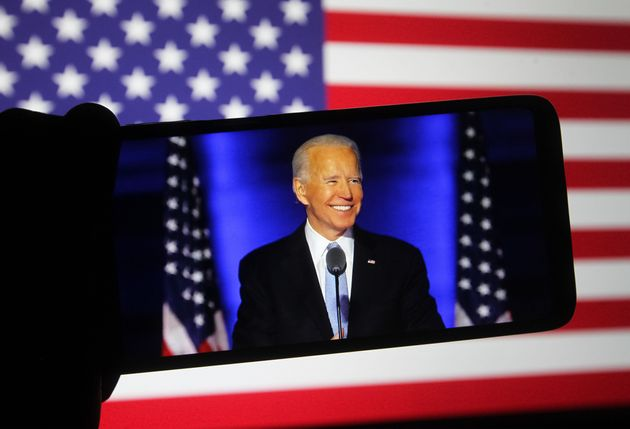 UKRAINE - 2020/11/08: In this photo illustration the US Democratic presidential candidate Joe Biden speaks...