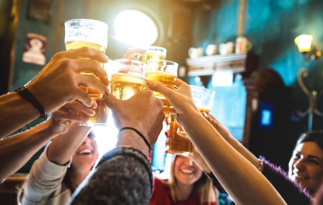 Group of happy friends drinking and toasting beer at brewery bar restaurant - Friendship concept with...