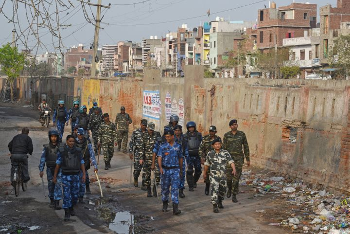 Rapid Action Force (RAF) personnel patrol the lanes at Shiv Vihar, Mustafabad, on March 1, 2020, in New Delhi, India.