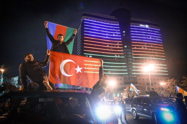 BAKU, AZERBAIJAN - NOVEMBER 10: Azerbaijani people celebrate the deal reached to halt fighting over the...
