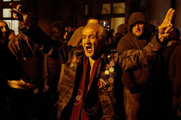 YEREVAN, ARMENIA - NOVEMBER 10: A veteran demonstrates outside Armenian Prime Minister, Nikol Pashinian's...