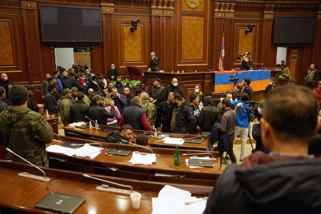 YEREVAN, ARMENIA - NOVEMBER 10: Protestors storm the Armenian parliament building after the announcement...