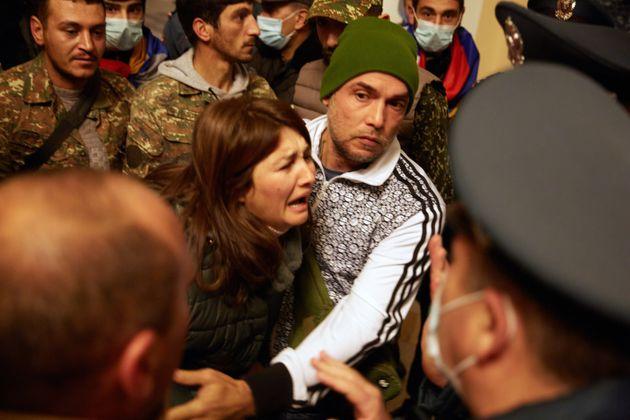 YEREVAN, ARMENIA - NOVEMBER 10: A bereaved woman cries among the protestors who have stormed Armenian...